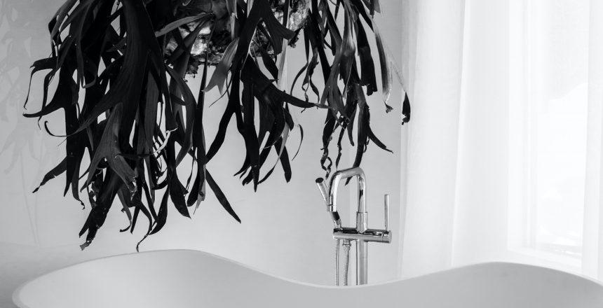 grayscale-photography-of-bathtub-near-window-1416244